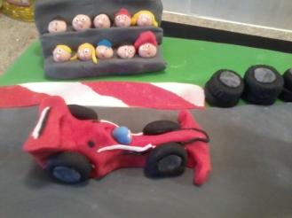 Racing Car and Spectators