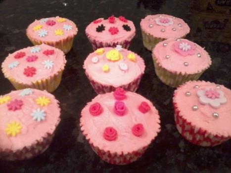 Vanilla Cupcakes With Various Sugar Craft Designs